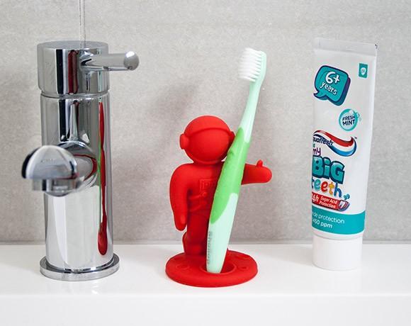 spaceman toothbrush holder sink